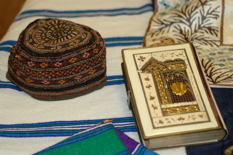 Yarmulka, prayer shawl and decorated Jewish prayer book