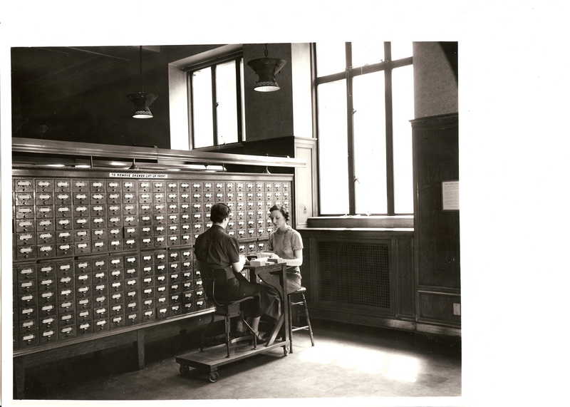 General Library Cataloging Department, Filing Cart in use at Public Catalog, May 1937 by Miss Mather and Miss Harkins