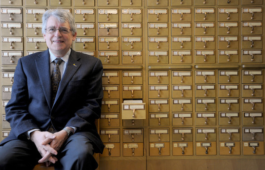Paul Courant, the Dean of Libraries, at front of the Card Catalog