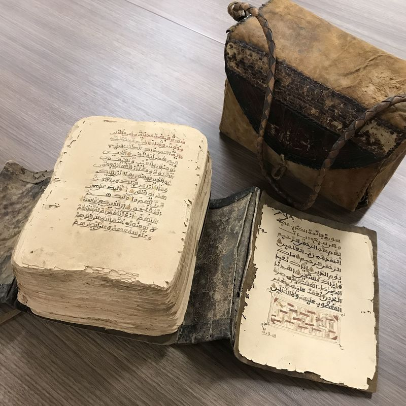 West African loose-leaf copy of the Qur'ān with wrapper and satchel
