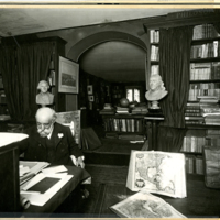 [Photo of Henry Vignaud in his library]