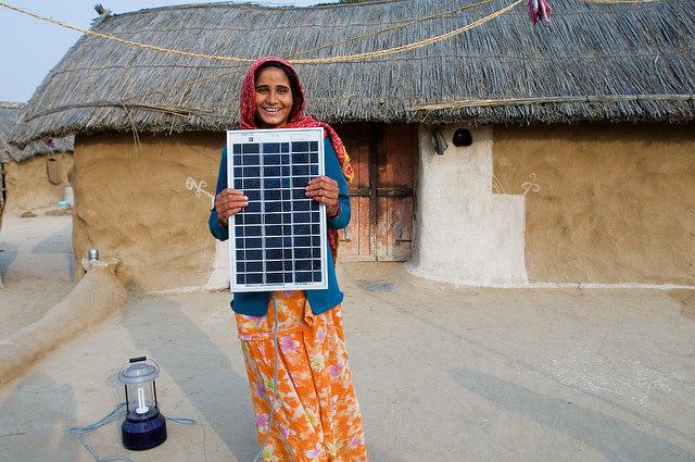 Woman holding solar panels