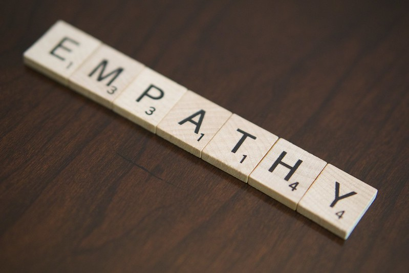 Photo of wooden tiles spelling the word empathy.