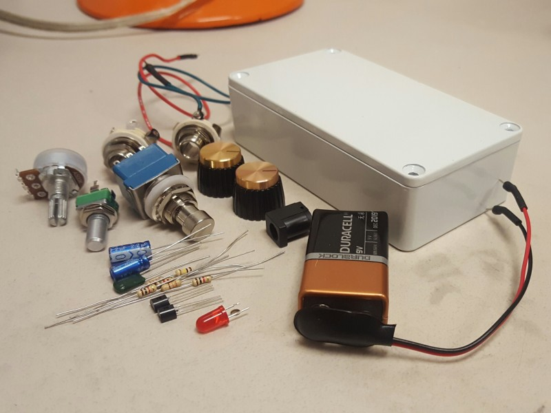 A metal enclosure and various electrical components.