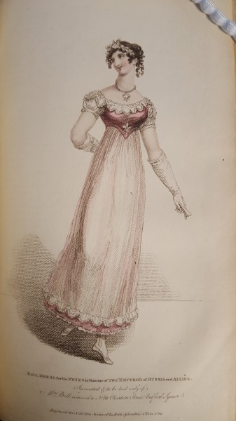 Woman dancing in a pink and white, ankle-length ball gown with empire waist. Hair is pulled back with a headband and put up in ringlets at the back of her head.