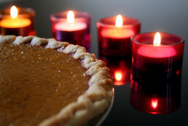 Photo of pumpkin pie and candles