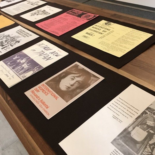 colorful pamphlets and documents laid out on a table