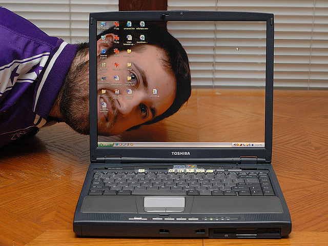 Photo of a computer screen that appears to be transparent.