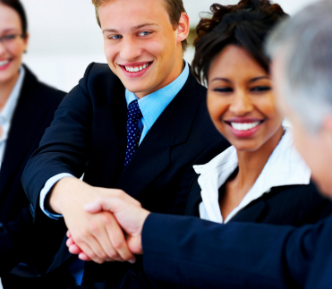 Photo of business people shaking hands