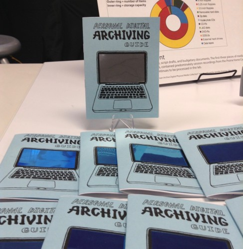 A table display of a collection of Personal Digital Archiving zines, with the image of a laptop on the cover with a mirrored screen