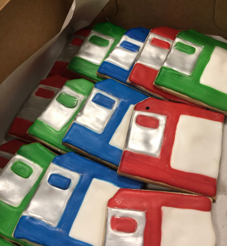 A box of sugar cookies decorated to look like 3.5-inch floppy disks