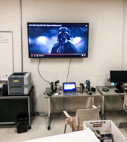 Large monitor with a Darth Vader clip playing