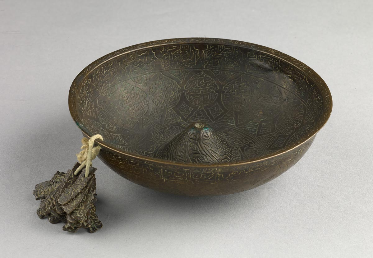 Magic bowl with attached prayer tablets