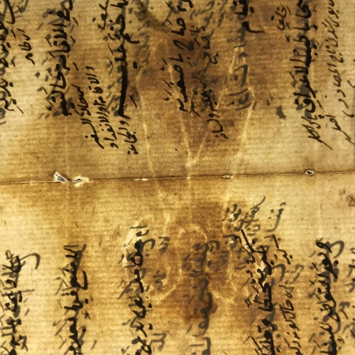 View of scissors watermark across the fold in Isl. Ms. 569 p.10/11