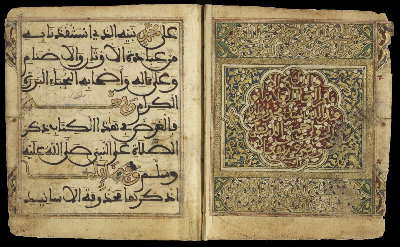 Double-page opening from a manuscript with Arabic writing in black, gold and colors, framed by vegetal designs