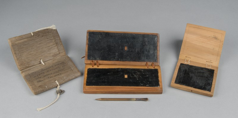 From left to right:Model of Roman wooden tablet; Wax tablet based on P. Mich. Inv. 3336, Karanis (Egypt), 1st-2nd century; Wax tablet based on P. Mich. Inv. 22185, Karanis (Egypt), 1st-3rd century