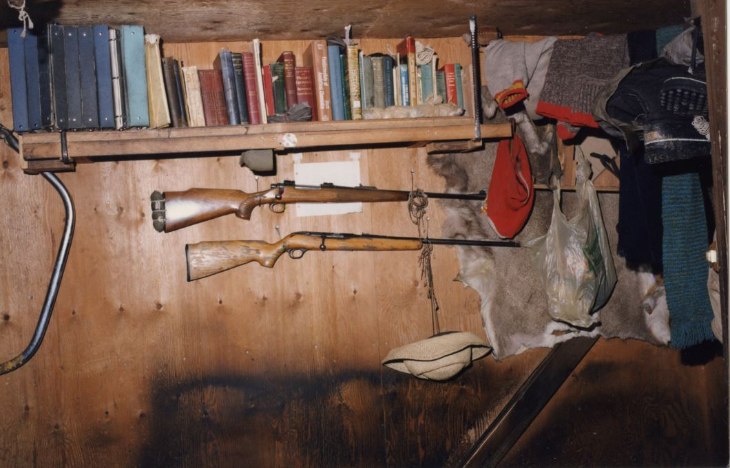 Inside Kaczynski's small cabin including books, hunting rifles and other items