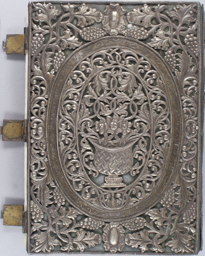 metal cover with floral motif