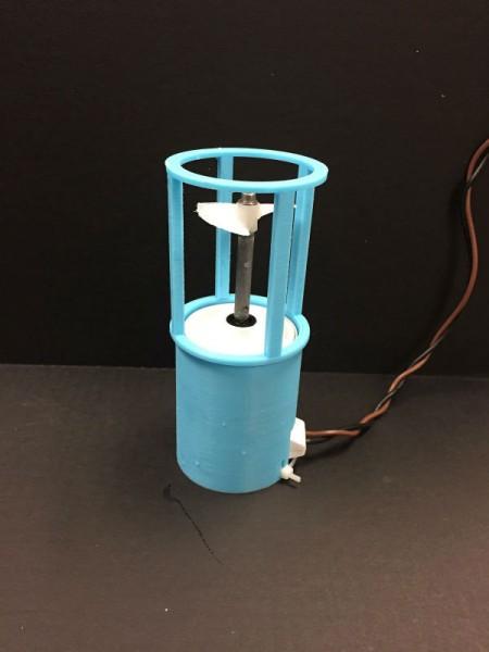 A light-blue 3D-printed thruster shroud