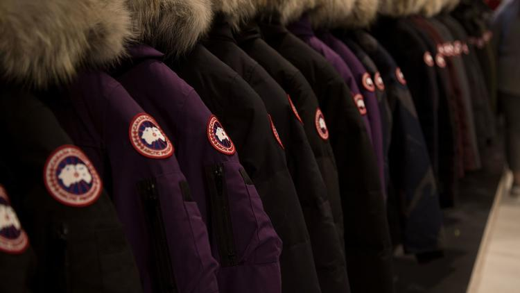 Image of a line of Canada Goose jackets on a rack