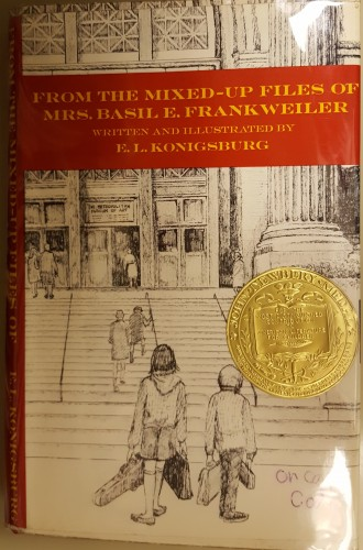 Cover of book showing a boy and girl in line drawing in the city