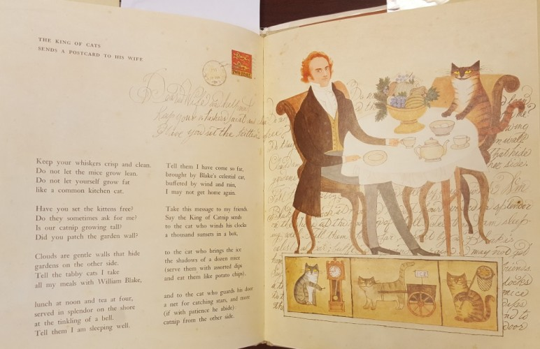 "On the left is the text of ""The King of Cats..."" and on the right is an illustration of a man and a cat eating at at cafe table"