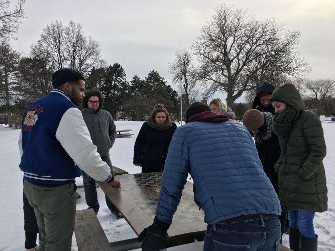 The Design Lab Residency with Kyle Bartell of Sit On It Detroit, in Palmer Park, planning a group project.