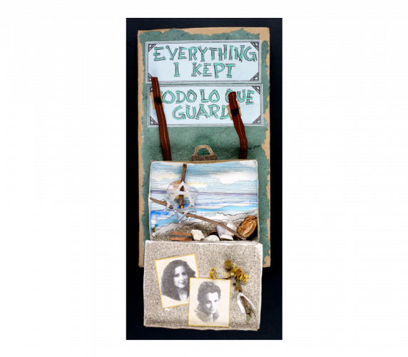 Cover with title in blue in English and Spanish, with a 3-d suitcase below, hanging open, containing a view of a beach and ocean, with real sea shells, a silver star of David, and two black and white photographs of the author.