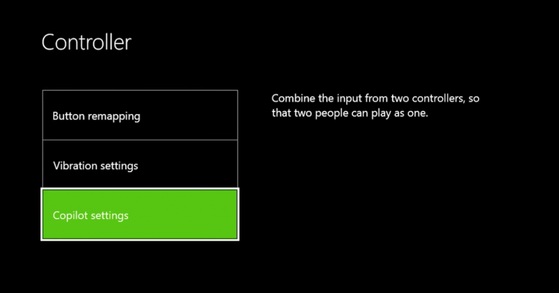 "The controller settings screen from the Xbox One. Three rectangular boxes are on the left side of the screen under the heading ""Controller"" in large white on a black background. The boxes, from top to bottom, read ""Button remapping"", Vibration Settings"", and ""Copilot Settings"", which is currently highlighted in neon Green. On the right side of the screen, co-piloting is explained with the text ""Combine the input from two controllers so that two people can play as one"
