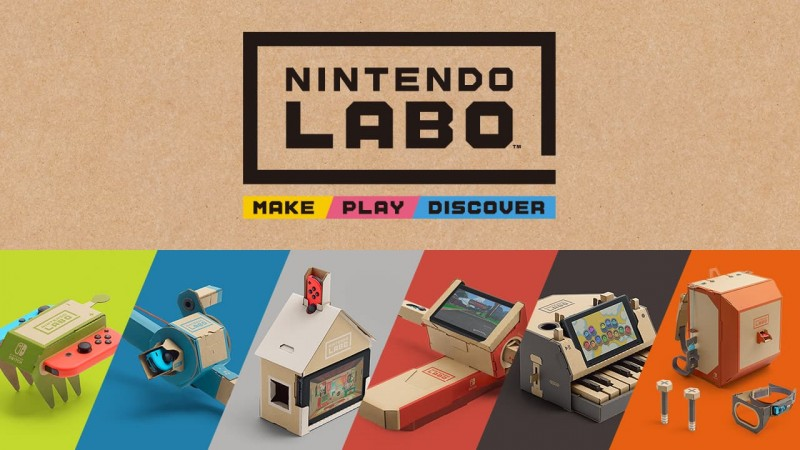 "The top half of the image has a brown background with text in the middle. The words "" Nintendo Labo"" are written in large black text, outlined with a thick black that forms a square except for a missing piece in the bottom right corner. Underneath, the words ""make"", ""play"", and ""discover"" are written in smaller black text on yellow, pink, and blue backgrounds, respectively. The bottom half of the image showcases several objects made from cardboard that are meant to be a green RC CAR, a blue fishing rod, a white house, a red motorcycle, a black piano, and an orange backpack"