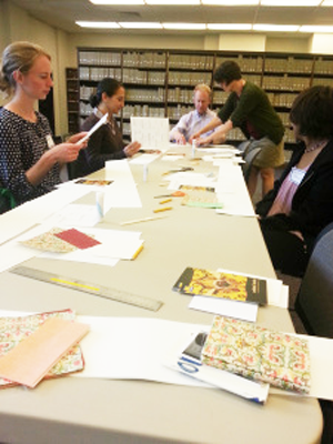 librarians cutting paper at a table