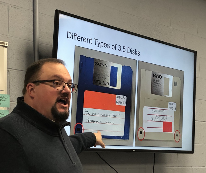 Lance Stuchell, Head of the Digital Preservation Unit, points at a screen display of 3.5-inch floppy disks during a World Digital Preservation Day event.