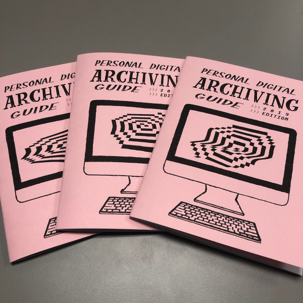 Copies of the Personal Digital Archiving zine, featuring a cover drawing of a desktop computer with a rasterized spiral on the screen