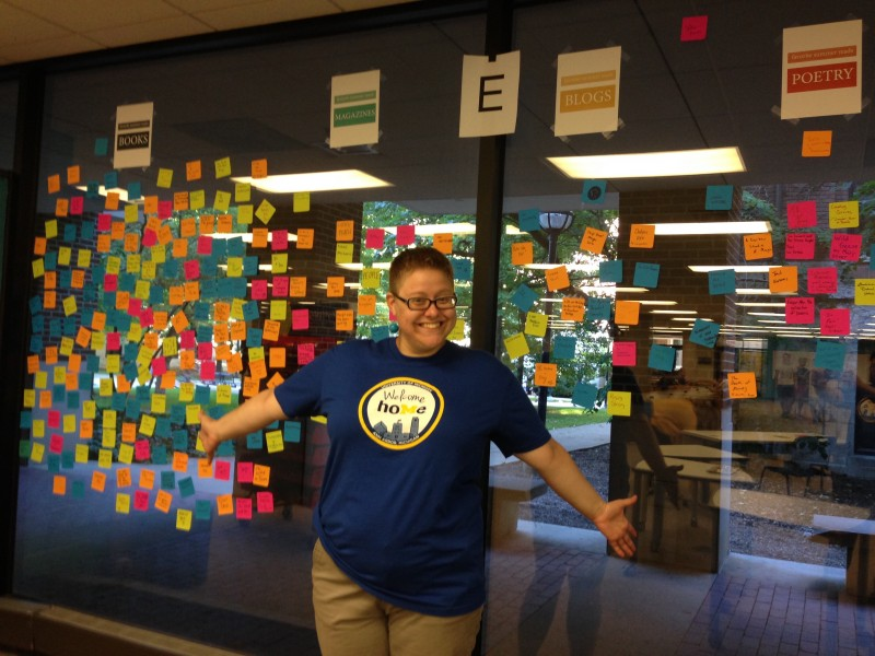 Photo of Faith with colorful Post-It notes stuck to a window