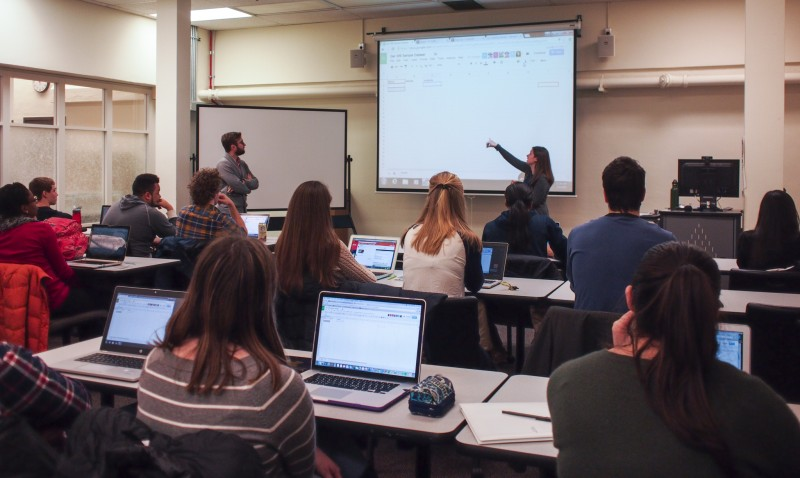 "Blake and Joque teaching mapping to the class ""Germany and the Blake Diaspora"" in a library classroom."