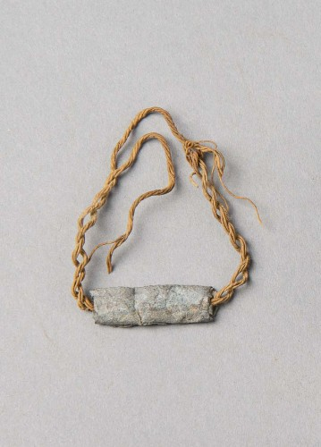 Amulet on a Bracelet. Karanis, Egypt; 3rd-4th c.AD. Lead, string; 220 x 80 mm. KM 24255. University of Michigan Excavations, 1928