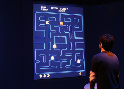 Person playing Pac-Man