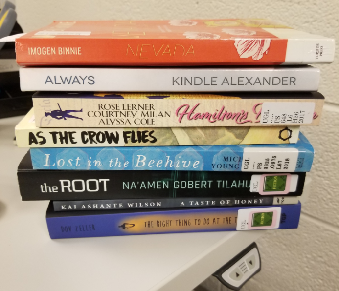 Pile of eight books on my desk
