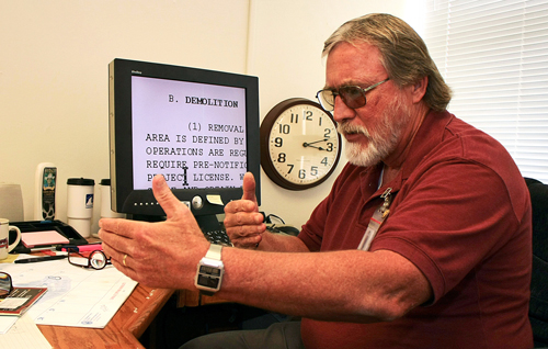 Person sitting at a desk using screen magnification software.