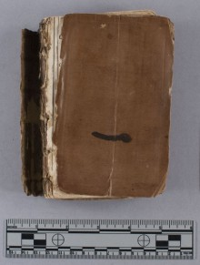 View of upper leather cover of book under discussion with ruler