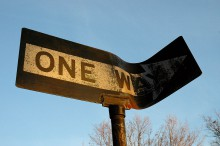 bent one-way sign