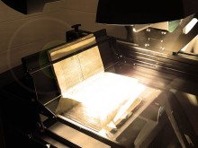 Image of tightly bound book being digitized on Quartz A1-V book scanner