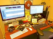 Work desk covered in different audio media formats
