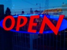 A open sign in a shop window