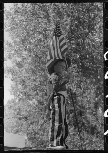 Digital file from negative of boy on Independence Day parade float
