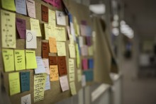 Photo of Post-It notes covering a wall in the Shapiro Design Lab by Bethany Hayden
