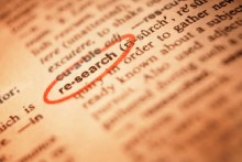 "Photo from a dictionary, highlighting the word ""research."""