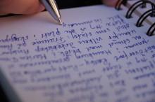 Photo of someone writing