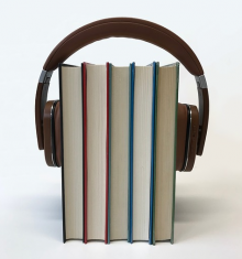 Headphones around five books
