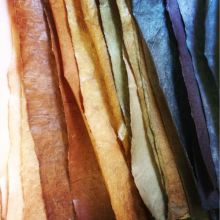 Dyed and burnished papers in a range of colors